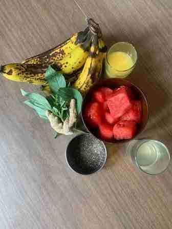 watermelon, banana, orange juice, coconut water, powder, basil leaves, chia seeds, ginger